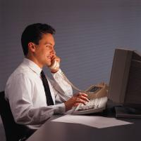 Business man in front of a computer