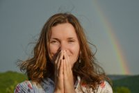 Woman standing in front of a rainbow, good fortune