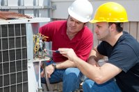 HVAC Technicians working on an A/C unit