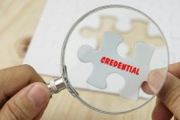 "Puzzle piece with the word ""credential"" on it"