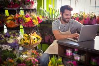 Professional Florist surrounded by blooms
