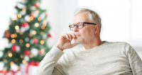 Man sitting in front of Christmas tree