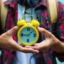 Student holding alarm clock