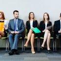 Row of male and female job seekers