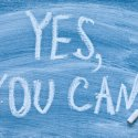 "Motivational message ""Yes you can!"" written on a chalkboard"