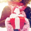 Smiling woman holding wrapped gift