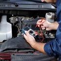 Automotive technician diagnosing engine trouble