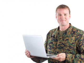 Military man holding a computer