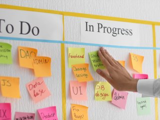 "Sticky notes on a ""To do"" list"