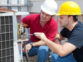 HVAC Technicians working on an A/C unit