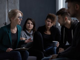 Female counselor leading a support group